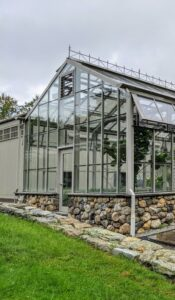 I love this greenhouse. Its construction in 2008 was inspired by Eliot Coleman, an expert in four-season farming. It uses minimal artificial heat – in fact, most of its energy comes directly from the sun, and it successfully grows a variety of cold-hardy crops all winter long.