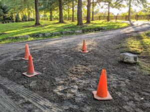 Finally, a new layer of gravel is placed in the location. Cones will remain until the ground is completely settled.