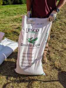 Next, Chhiring prepares the seed. We chose a good quality seed from Lesco Inc., a company that specializes in turf seed for large areas such as lawns, golf courses and sports fields to roadsides and sod farms.