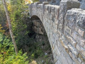 Looking under the bridge, one can see part of the cliffside.