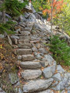 These are the steps along the steep Spring Trail up to Penobscot Mountain, the fifth highest peak in Acadia. It is an impressive north-south mountain that sits opposite Pemetic Mountain near Jordan Pond. A hike up the Spring Trail is strenuous and best for more experienced hikers.