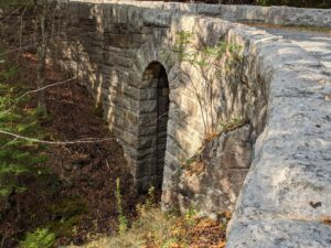 Despite being 115 feet in length, this is a somewhat understated bridge located just west of the Jordan Pond House. This is the West Branch Bridge built in 1931. It is 115 feet in length and 22 in height. A single narrow six foot wide arch stands above the usually dry stream bed.