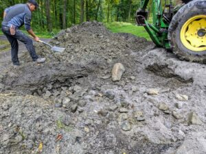 Next, all the ground dirt, gravel and other loose materials are returned to the area over the hole and leveled.
