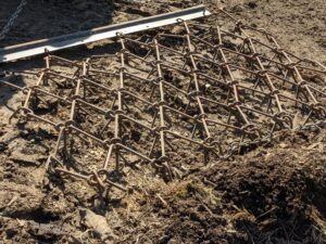 It works by going over the ground in one pass to prepare soil for seeding.