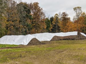 I keep the aging materials covered with white tarps to trap heat and help 'cook' the compost. I just love that all of my garden beds are top-dressed and enriched with gorgeous compost made right here on the farm.