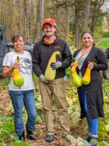 Elvira, Ryan, and Enma are so pleased with how productive our pumpkin patch was this year.