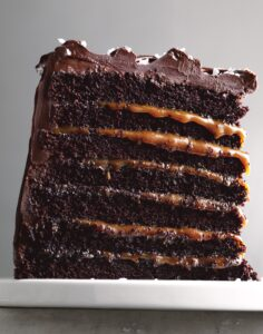 This is our mouthwatering Mile-High Salted-Caramel Chocolate Cake. This one is for chocolate lovers – it is made with rich salted caramel, layers of chocolate cake, and dark chocolate frosting. (Photo by Johnny Miller)