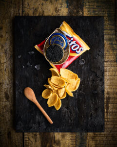 Recognize this combination? This is Jenny Laird's Texas Caviar, an appetizer at The Capri inspired by our own Kevin Sharkey who loves serving Fritos Corn Chips with the finest caviar. I love it too - have you tried it? (Photo by Douglas Friedman)