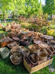 Inside, I have many, many baskets. A good number of these baskets were used during my catering days. Here they are all taken out of the structure and carefully placed on the lawn, so they can be dusted and reorganized.