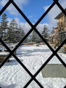 "This is the same view from inside through a leaded window in the dining room. With the snow cover, it's hard to see the large ""cracked ice"" terrace, but one can make out the paved outline."
