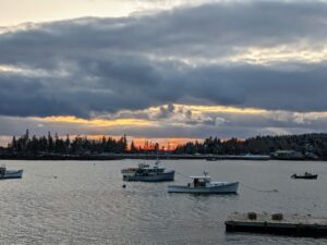 In the late afternoon, Cheryl walked to the town dock for this image of the setting sun over Seal harbor.