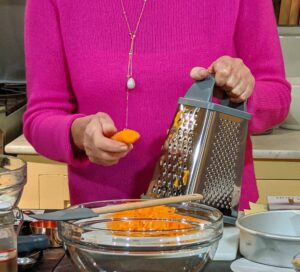For this carrot cake recipe, five medium carrots are peeled and then shredded on the fine holes of a box grater.
