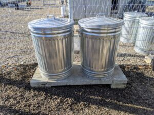 Here are two metal bins on the slab - these bins will last a long time, now that they are raised off the ground.