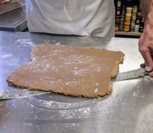 Robert never rolls out dough without a metal ruler close at hand. He says he never worries about the dough sticking to the surface - a straight edged metal ruler pulls it up perfectly every time.