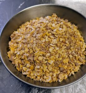 This is a traditional grated craquelin butter crunch recipe for the topping with added gold leaf powder, so the cookie shimmers. The literal translation of craquelin means cracker, but when referring to French pastries, Craquelin is a cookie topping that offers a distinct sweet and crunchy texture.