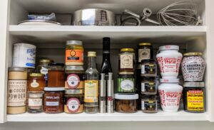 In the back of the kitchen, shelves of ingredients - pure honeys, syrups, spices, fruit flavored waters, and more.