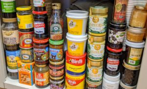 On another shelf, stacks of almond paste, jams and spreads, and ghee which is clarified butter that originated in ancient India. It is commonly used in Indian cuisine, Middle Eastern cuisine, Southeast Asian cuisine, traditional medicine, and religious rituals.