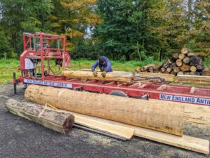 After a cut is complete, the log is turned and run through the cutter again.