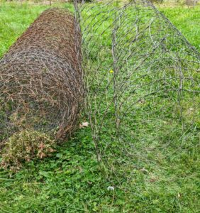 The original fencing served its purpose, but it was time to replace it and put up a more durable fence that would look nice, and protect all my poultry, waterfowl, and Guinea fowl. Here is some of the old fencing that was removed. It is all rolled up and ready to be discarded.