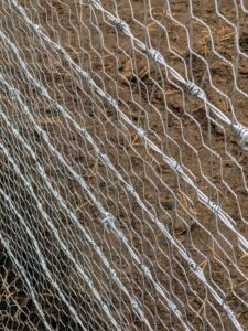 A poultry safe wire netting is also secured on the inside lower half all around the perimeter. Here, one can see the two layers.