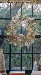 Here is my Lit Glittered 24 inch Fern Wreath. It adds a glittery glow to any window. It includes 30 warm white LED lights and can be controlled to stay steady or twinkle in a variety of times and speeds.