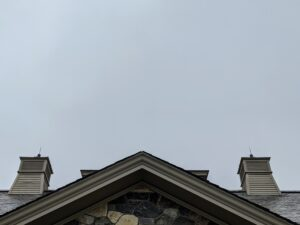 Looking above the stable, the sky is completely covered in clouds.