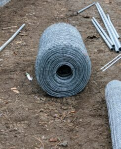 This new roll of fencing fabric is from a company called Red Brand Fence Co. in Peoria, Illinois - the only company in the world that makes this type of fencing.