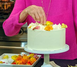 This is our Citrus Cake with Edible Blossoms - a lemony cake with a lime-mousse filling and covered in a delectable Italian meringue buttercream frosting. I covered it with beautiful blossoms, meringues and sugar-pearls.