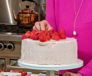 """I also showed this gorgeous Vanilla Sponge Cake with Strawberry Meringue. Here I am placing lots and lots of sweet strawberries on top. Take your time decorating and make it as perfect as possible, and always """"bake with aplomb"""" - confidence and assurance. If you were part of my class, yesterday, you'd remember this important tip."""