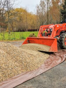The gravel is delivered from a nearby pile to the chicken coops in our Kubota model M7060HD12 tractor – a vehicle that gets used at the farm for a myriad of tasks - pulling or pushing agricultural machinery or trailers, for plowing, tilling, transporting and so much more.
