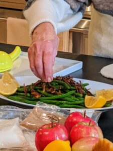 Next, I season them with salt and cut wedges of lemon to serve. I don't like to squeeze lemon over the beans because the acid can alter the bold green color of the beans, but serving guests with their own lemon wedge allows them to add the juice themselves.