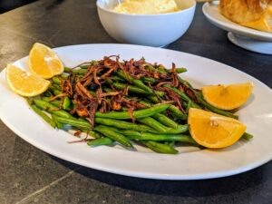 The Green Beans with Crispy Shallots and Lemon are sure to go quickly.