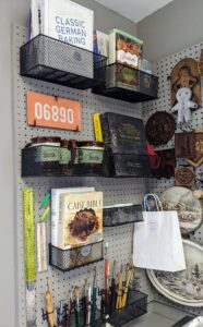 When Robert set-up this kitchen, most of the peg board was already in the room so he painted it and added more hooks and holders to store and display his books, tools, and other keepsakes. Hanging them saves time from rummaging through a drawer or bin to find what's needed.