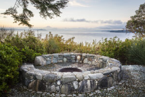 The council ring is the heart of the Windcliff garden. Commonly known as a fire pit, it was built by craftsman Jeffrey Bales in 2002 - all the rocks and pebbles meticulously hand-selected and thoughtfully positioned. (Photo by Claire Takacs)