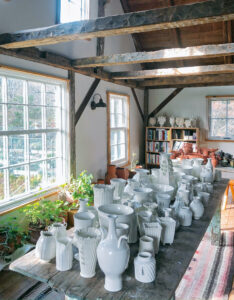 This is a view from the second floor of her barn studio overlooking some of her ceramics for sale. Frances places her pots on one large table, so customers can see the various one-of-a-kind shapes. (Photo by Frances Palmer)