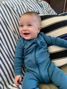 Leo is growing fast - his mom says he's already outgrown clothes for his age - this onesie is for 9-month olds.