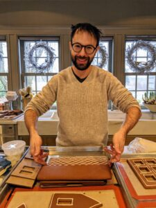 """Longtime """"Living"""" contributor and author of the new book, """"Fruit Cake: Recipes for the Curious Baker,"""" Jason Schreiber, helped me create a beautiful gingerbread village for the party. My Winter House kitchen was bustling with activity."""