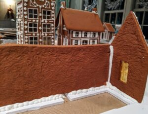 Here is the inside of two walls - all carefully connected with delicious royal icing. Finished houses dry in the background.