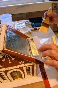 Here I am using silver-leaf foil to decorate the the top of this roof. We worked late into the night, but it was so much fun.