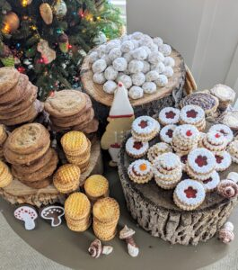 I love to incorporate natural elements whenever possible. Here in the woodland Christmas themed Tenant House, cut tree stumps hold stacks and stacks of cookies - Alexis's brown-sugar chocolate chip cookies, four-ingedient sables bretons, bourbojn-spiked Noel nut balls, raspberry and apricot jam filled pecan linzers, and sugar cookie mushrooms.