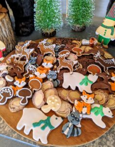 """On the day of the party, guests were told not to miss the """"Cookie House"""" – Alexis's little Tenant House was filled with sweet treats. We made about 2500-cookies in all. Many of the recipes are from my books and my web site at MarthaStewart.com. In this house, they were surrounded by whimsical woodland animals and miniature cookie figurines – the children loved this house the best."""