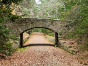 This is the Jordan Pond Road Bridge, sometimes called the Jordan Pond Seal Harbor Bridge. It is located just one-tenth of a mile east of the Stanley Brook Bridge, and connects with the hiking trail called the Day Mountain loop.