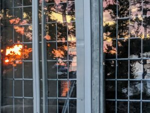 Cheryl took this photo of the sunset's reflection in the windows of my Living Hall - just as pretty as the actual view.