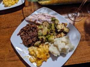 Here's Cheryl's plate - filled with traditional turkey, Torrey's short ribs, and all those well-loved sides - roasted Brussels sprouts with bacon, homemade dressing, mashed potatoes with truffle oil, and macaroni and cheese.