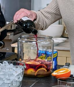 We started by making a refreshing Sangria. Sangria, Spain's most loved and celebrated cocktail, is a boozy fruit punch made with wine and fresh seasonal fruits. While it has roots in Spain, it's now popular all around the world.