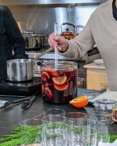 The recipe for this Winter Fruit Sangria is on my web site at marthastewart.com. It includes brandy, sugar, citrus, apples, well-chilled red wine, club soda, and orange juice. We're using a wonderful red from our own Martha Stewart Wine Co.