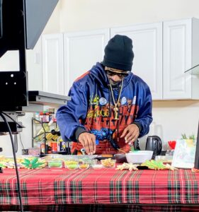Snoop joined the event from his home in Los Angeles. Here he is decorating some of his cookies on-camera.