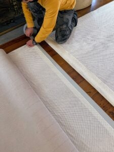 Half the length of the tape is left bare to stick the second piece of padding on top.