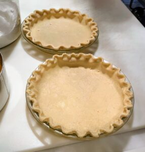 The night before Thanksgiving is always busy with preparations. This year, I made 24-pies - some to enjoy with family and friends, but most to give away to my hardworking staff - a tradition I do every year. Here are two perfect pie crusts. I have been making this pate brisee for many years and have perfected this recipe. It calls for two-and-a-half cups all-purpose flour, one teaspoon kosher salt, one teaspoon granulated sugar, two sticks unsalted butter, and a quarter to a half cup of ice water.