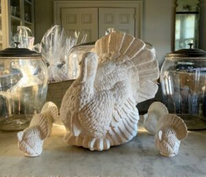 Whenever I entertain, I always like to decorate my Winter House. For Thanksgiving, we had lots of beautiful turkey figures such as these. I made these turkeys years back for a shoot. We casted numerous turkeys from a material called PermaStone, a lightweight, durable cement and then gently tinted them in various earth tones. They look so beautiful sitting on my servery counter.